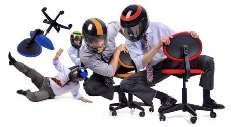 Businessmen with helmets racing in chairs